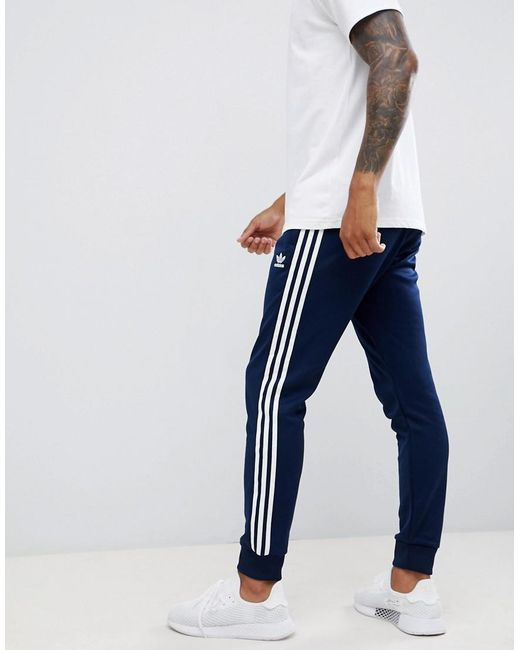 Adidas Originals - Blue 3-stripe Skinny joggers With Cuffed Hem In Navy  Dh5834 for ... 665283bc20c1