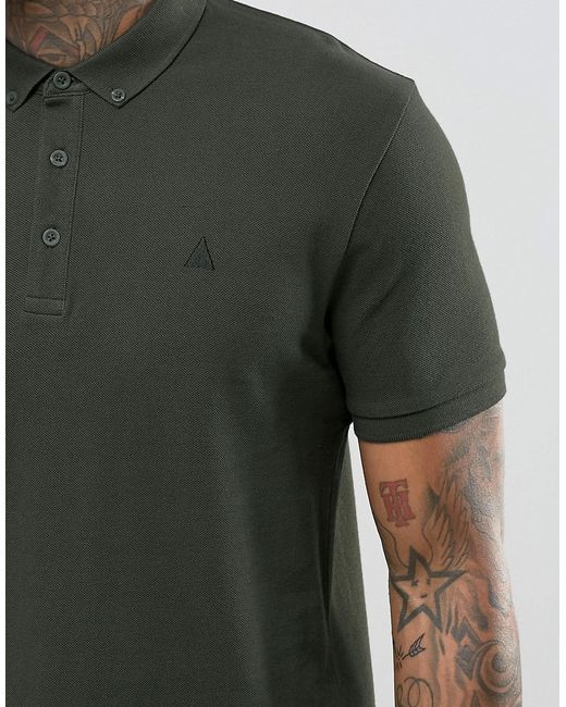 A black shirt with khaki pants sends a mixed message to the audience: khaki signals casual, while black shirt says formal. Style is about the story you want to tell the world. The shirt could be anything from a black t-shirt to a black polo or button down. Usually I'd wear a black belt and black shoes or sandals with it, depending on where.