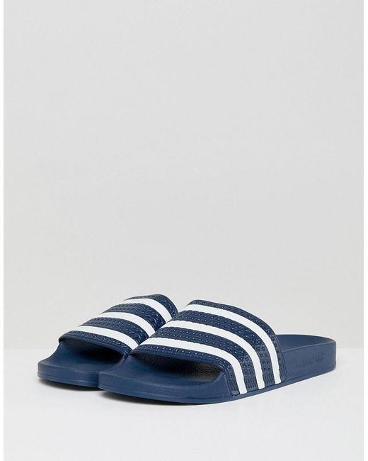 7fc01de9331d90 Adidas Originals - Blue Adilette Sliders In Navy 288022 for Men - Lyst ...