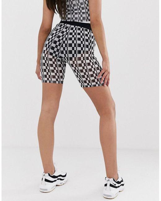 50b36f91 ... Fila - Black legging Shorts In Sheer Checkerboard Two-piece - Lyst