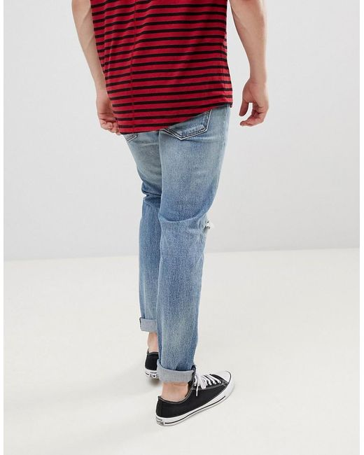 47730b61c07 ... Levi's - Blue 512 Slim Tapered Low Rise Knee Rip Jeans In Monsoon Light  Wash for. Visit ASOS