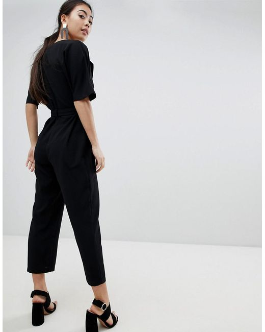 3523ef46f0b ... ASOS - Black Asos Design Petite Wrap Jumpsuit With Self Belt - Lyst
