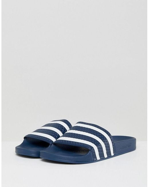 8a11eb4b43cd Adidas Originals - Blue Adilette Sliders In Navy for Men - Lyst ...