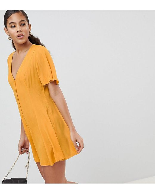 e391f8b8aa6 ASOS - Yellow Asos Design Tall Swing Romper With Button Detail - Lyst ...