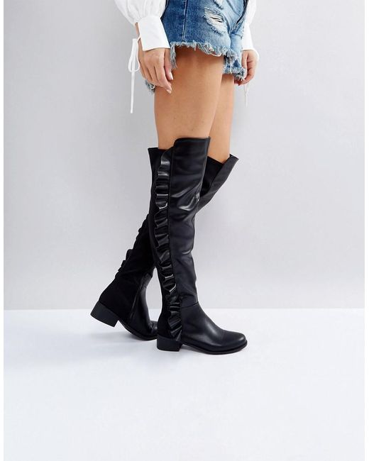 d2bddd96ede Truffle Collection - Black Ruffle Flat Over Knee Boots - Lyst ...