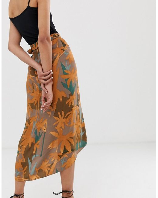 99be318ad1 ... Other Stories - Brown Curved Hem Midi Wrap Skirt In Tropical Leaf Print  - Lyst