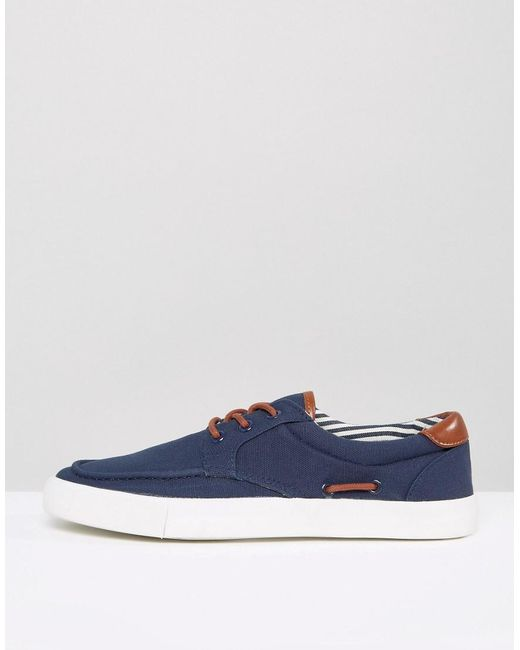 asos boat shoes in navy canvas with contrast detail in