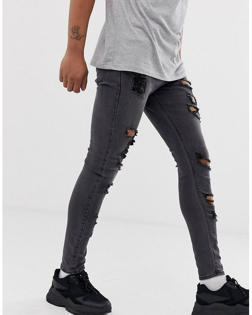 63f0788a3d51a ... ASOS - Spray On Jeans In Power Stretch With Heavy Rips In Washed Black  for Men