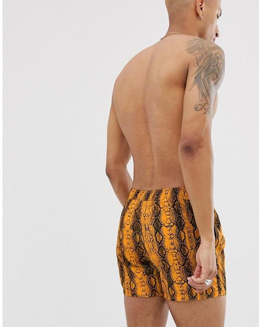 18c284c2b5 ... ASOS - Swim Shorts In Neon Orange Snake Print Short Length for Men -  Lyst