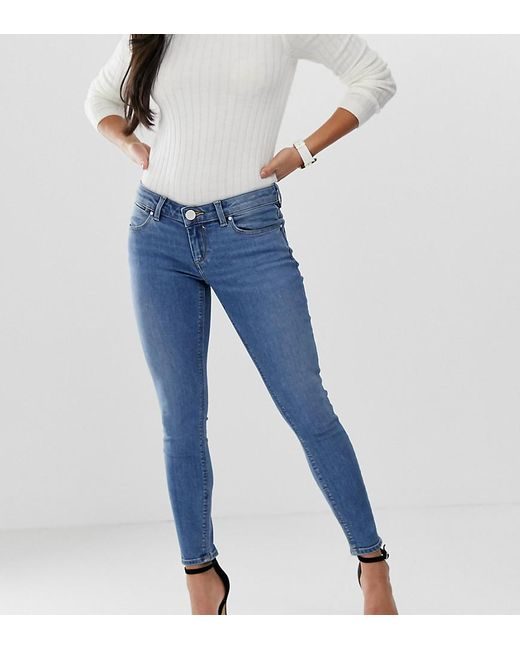 665c5919f ASOS - Asos Design Petite Whitby Low Rise Skinny Jeans In Mid Wash Blue -  Lyst ...