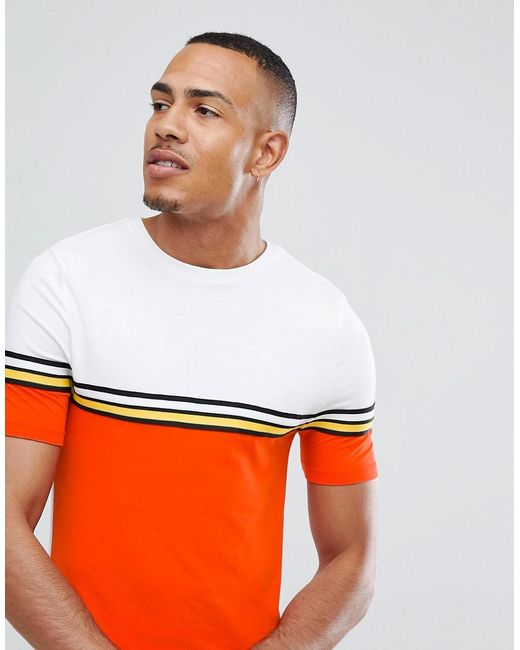 DESIGN muscle longline t-shirt with bright colour block and taping in orange - Warning Asos