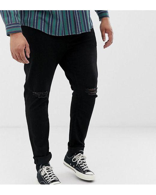 805a7e72a2f ASOS - Black Vaqueros ajustados en negro de tejido reciclado con rodillas  rasgadas de Plus for ...