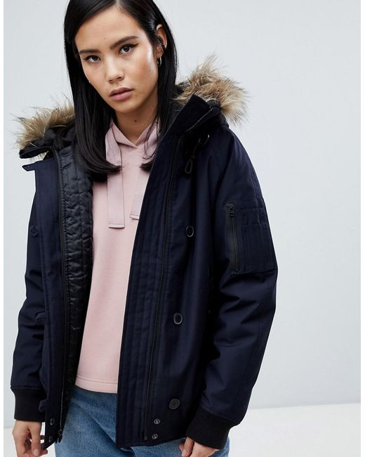 380ec1934badf Fred Perry - Blue Short Parka Jacket With Faux Fur Hood - Lyst ...