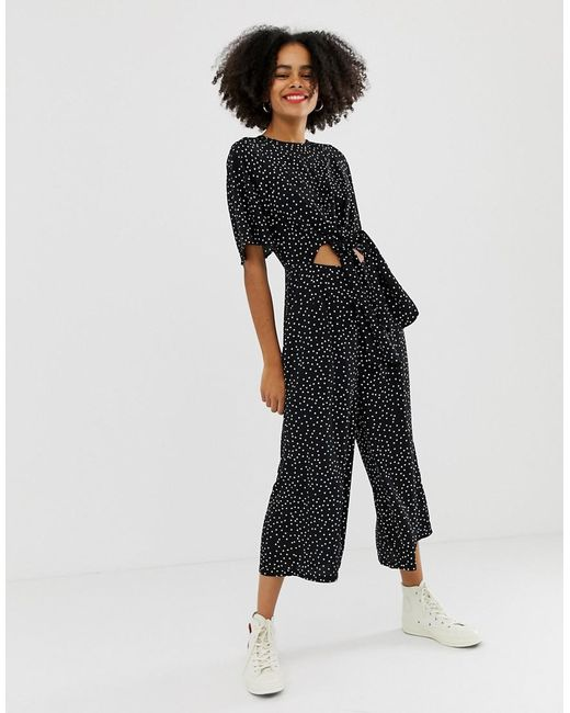 da734496105 Glamorous - Black Relaxed Jumpsuit With Tie Front In Spaced Spot Print -  Lyst ...