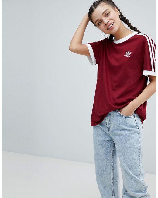 Lyst adidas Originals Adicolor tres Stripe camiseta en Borgoña en rojo