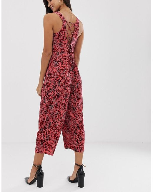 b0f4dfc303 ... ASOS - Red Jumpsuit With Tie Back Detail In Animal Print - Lyst