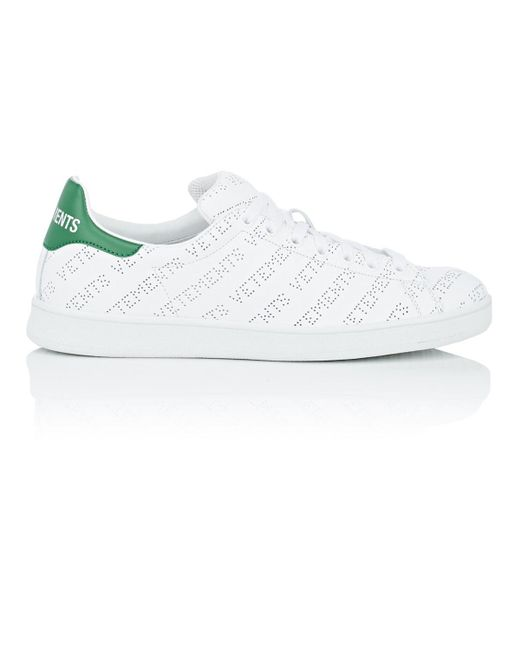 sports shoes 9e894 0ea8d vetements-White-Green-Logo-perforated-Leather-Sneakers.jpeg