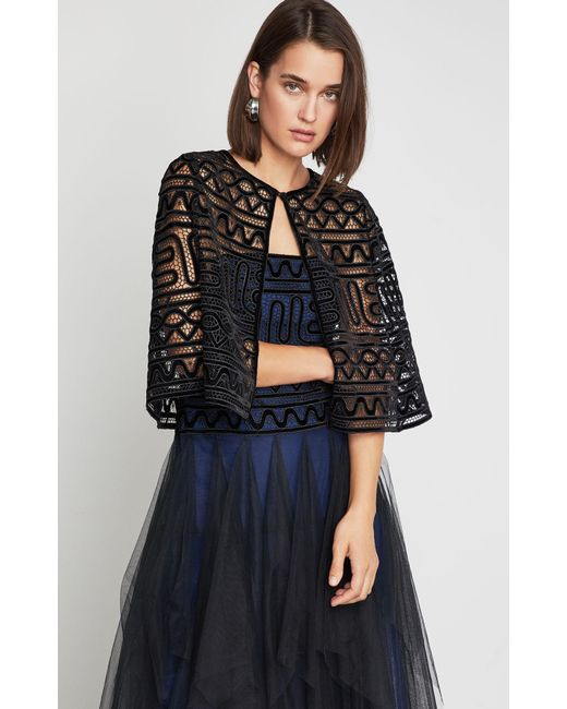 Lyst - BCBGMAXAZRIA Bcbg Cropped Lace Cape in Black - Save 38% 617d73890