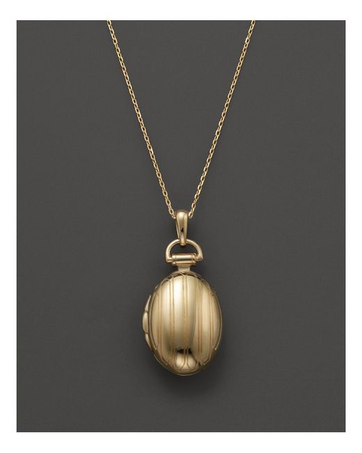 Monica Rich Kosann | Metallic 18k Yellow Gold Petite Pinstripe Locket Necklace, 17"
