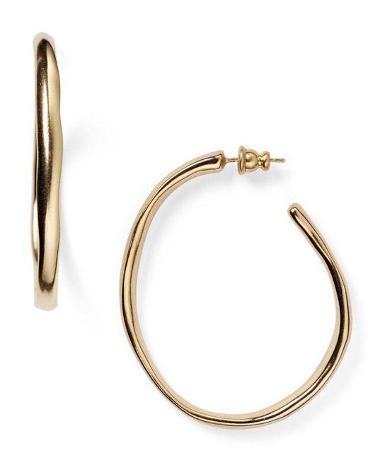 Uno De 50 - Metallic Ohm Hoop Earrings - Lyst