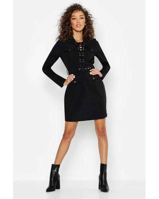 22adf7cea74c Boohoo - Black Lace Up Front Utility Mini Dress - Lyst ...