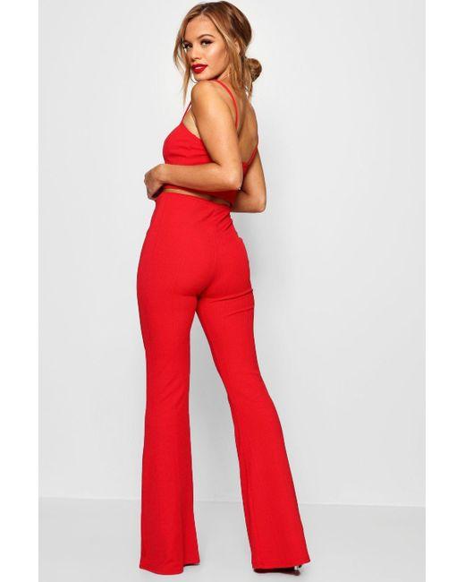 980bb04895b60 ... Boohoo - Red Petite Bandage Flare Pants Co-ord - Lyst