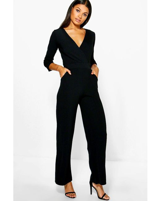 5a14df933a9 Boohoo - Black Roll Sleeve Relaxed Wide Leg Jumpsuit - Lyst ...