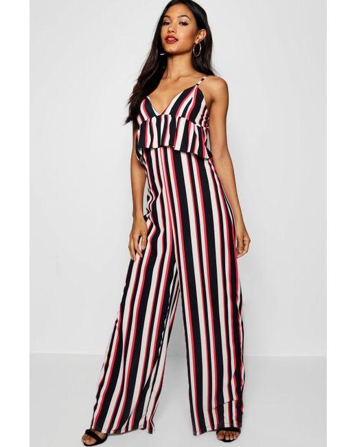 4cf74a275f1 Boohoo - Black Stripe Ruffle Peplum Frill Strappy Jumpsuit - Lyst ...