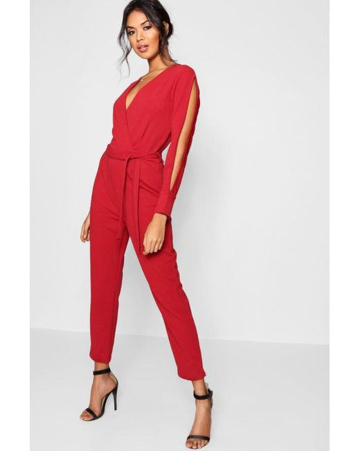 3f8dafbb0b Boohoo - Red Split Sleeve Wrap Over Smart Jumpsuit - Lyst ...
