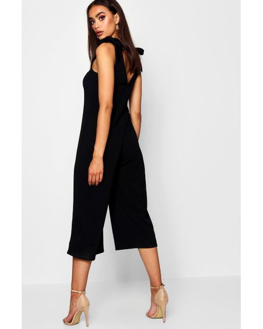40f85ef1769b ... Boohoo - Black Horn Button Detail Swing Jumpsuit - Lyst ...
