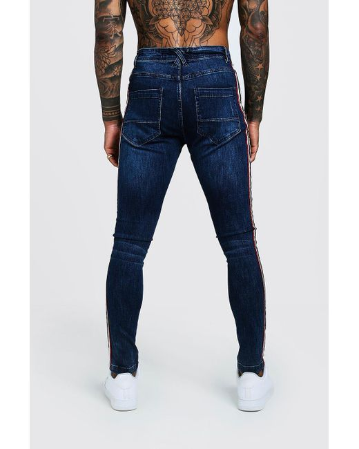 b0d754e294ce1 ... BoohooMAN - Blue Super Skinny Distressed Jeans With Side Tape for Men -  Lyst ...