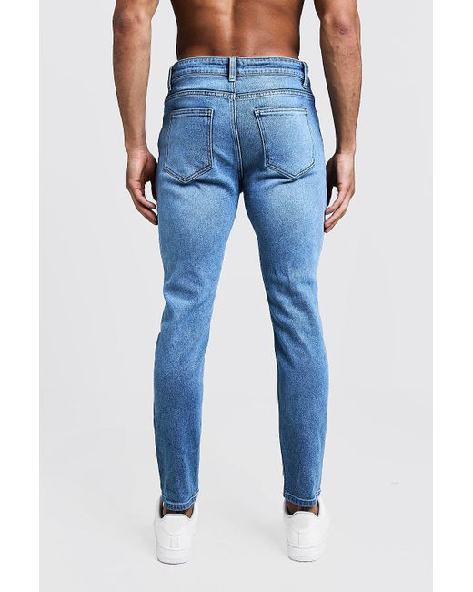 2da9acca2b182 ... BoohooMAN - Blue Skinny Fit Jeans With Ripped Knees for Men - Lyst ...