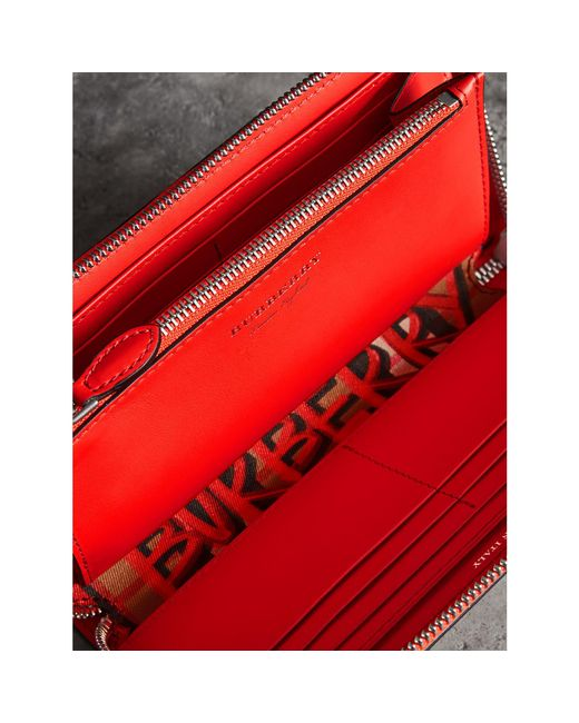 5ad6b9595a0 ... Burberry - Red Graffiti Print Vintage Check Leather Ziparound Wallet -  Lyst ...