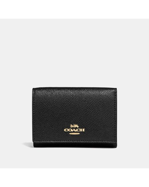 4aa51645a894 Lyst - COACH Small Flap Wallet in Black