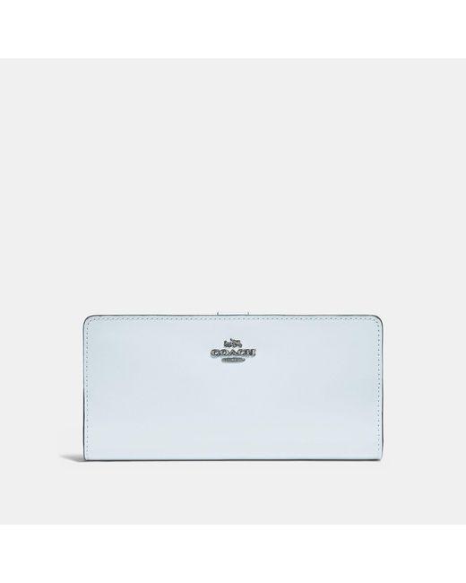 COACH - Blue Skinny Wallet - Lyst