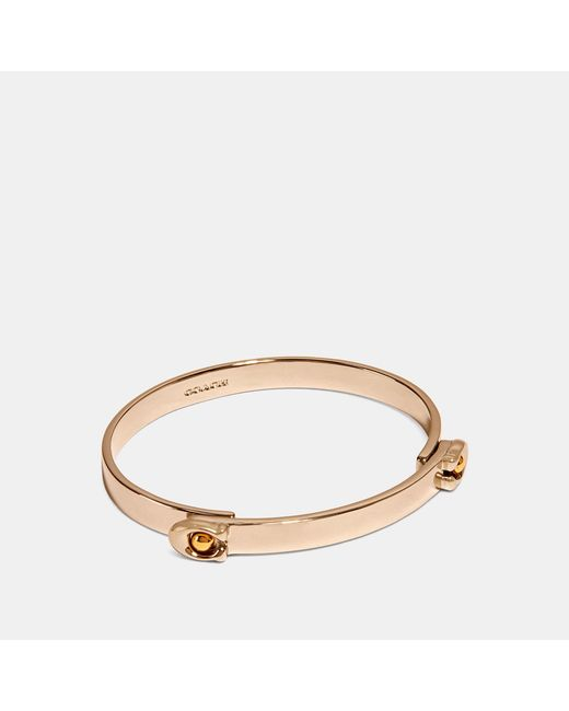 COACH - Metallic Sculpted Signature Tension Hinged Bangle - Lyst