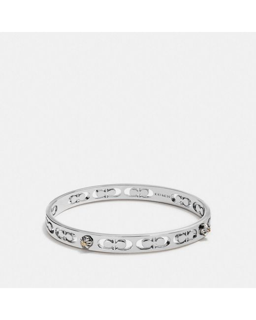 COACH | Metallic Daisy Rivet Pierced Kissing C Bangle | Lyst