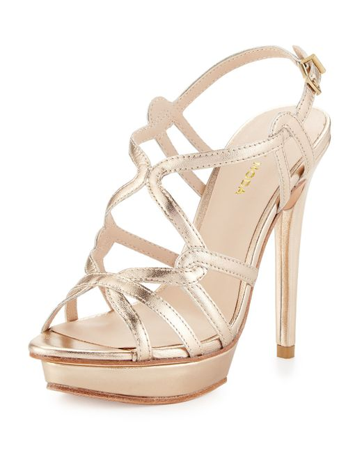 pelle moda flirty sandal aqua Bring some funky bling to a flirty dress with pelle moda's vivien sandal this edgy shoe features a t-strap design accented with tonal jewels surrounded by shiny studs.