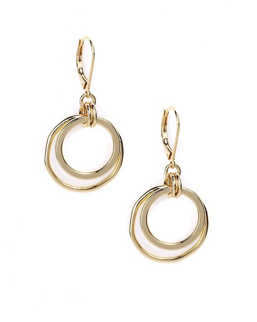 klein goldtone orbital hoop earrings in gold lyst