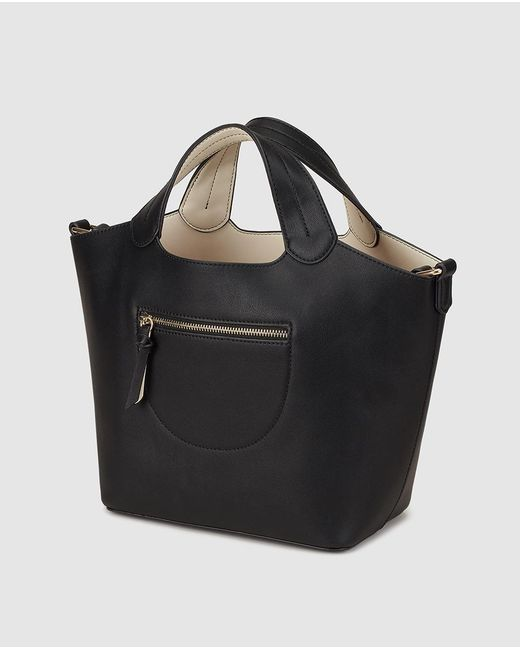 f46472f850 ... El Corte Inglés - Small Black Handbag With Removable Toiletry Bag - Lyst  ...
