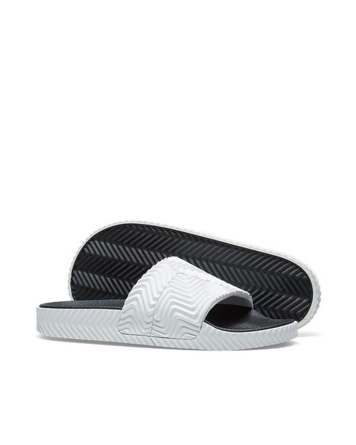 57a92dffbc0e ... Alexander Wang - White Adilette Rubber Slide Sandals for Men - Lyst ...