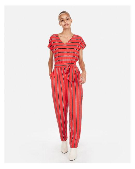 785e9a693e2 Lyst - Express Petite Stripe V-neck Short Sleeve Jumpsuit in Red