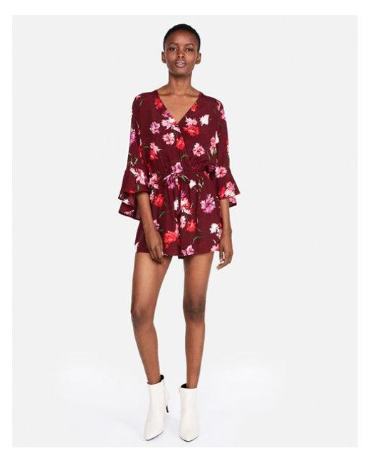 c6609ea0c48 Lyst - Express Petite Floral Surplice Bell Sleeve Romper in Red