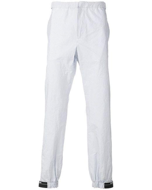Prada - Blue Striped Logo Patch Trousers for Men - Lyst