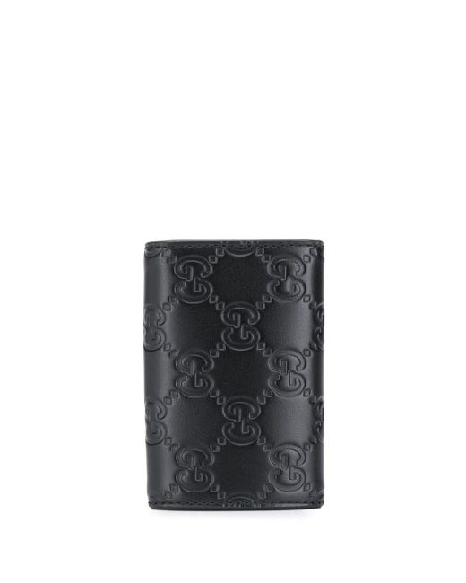 e53cf1797569 ... Gucci - Black Signature Embossed Key Holder for Men - Lyst ...