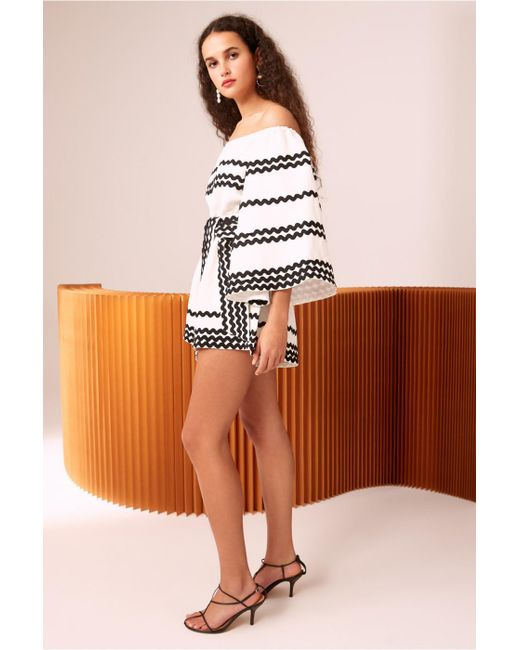 42667613a51 ... C meo Collective - White Incise Off The Shoulder Bell Sleeve Romper -  Lyst ...