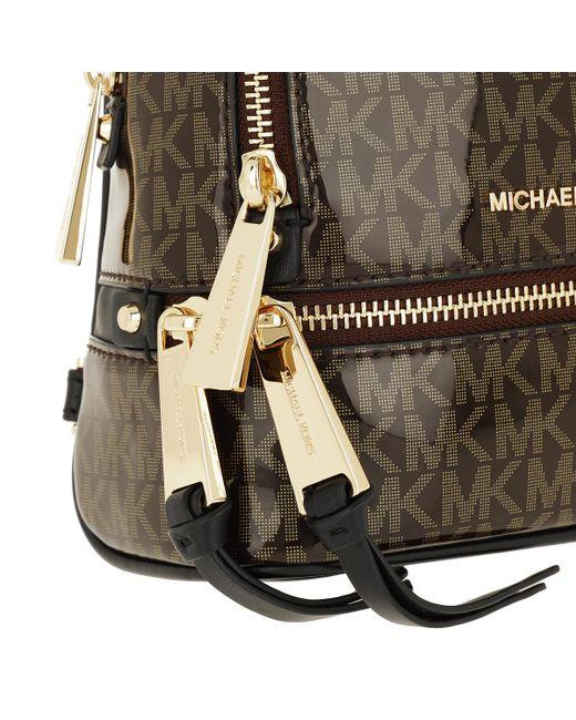 e60f83ed1b5d ... MICHAEL Michael Kors - Rhea Zip Xs Messenger Backpack Brown gold - Lyst  ...
