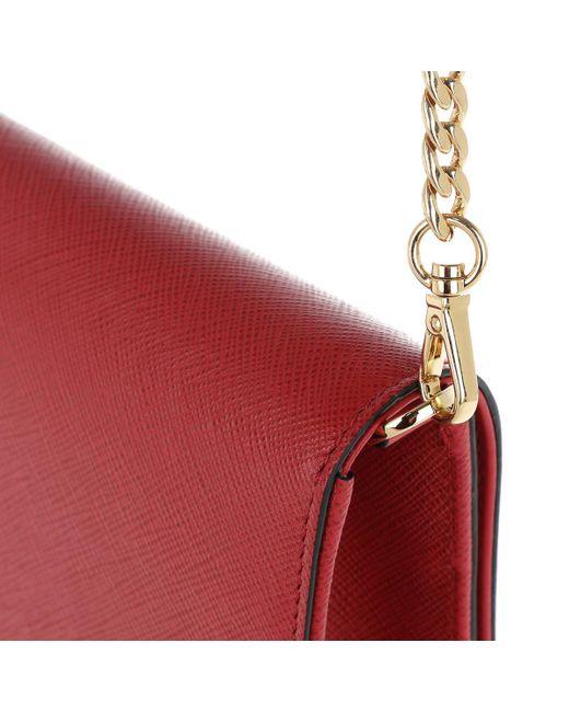 e2b62983ea00 Lyst - Prada Baguette Crossbody Bag Saffiano Red in Red