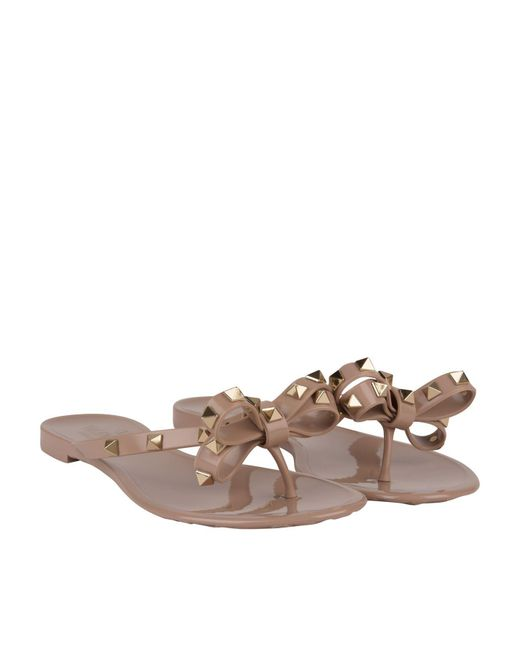 07c65379891f Lyst - Valentino Rockstud Jelly Flip Flops in Brown - Save 37%
