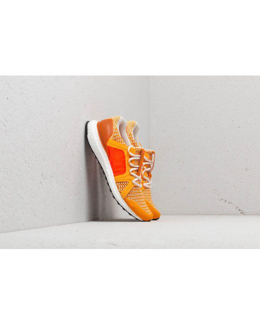 f0975bc92f03b Footshop - Adidas X Stella Mccartney Ultraboost Cold Gold  Rus Orange   Turbo - Lyst ...
